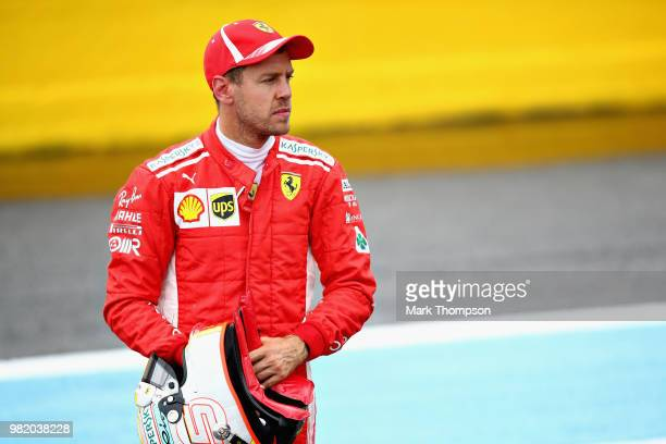 Third place qualifier Sebastian Vettel of Germany and Ferrari looks on in parc ferme during qualifying for the Formula One Grand Prix of France at...