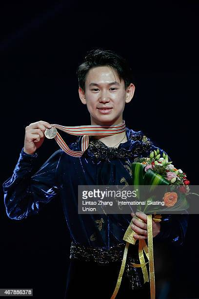 Third place winner Denis Ten of Kazakhstan pose on the podium after the medals ceremony of the Ice DanceMan Free Skating Program on day four of the...