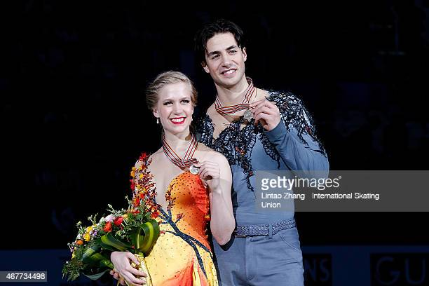 Third place winner Kaitlyn Weaver and Andrew Poje of Canada pose on the podium after the medals ceremony of the Ice DanceFree Dance on day three of...