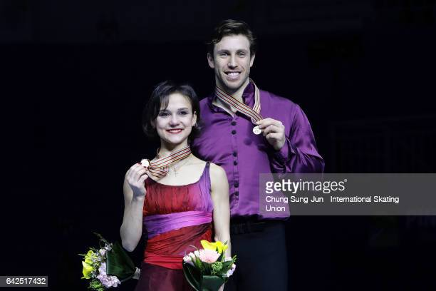 Third place winner Liubov Ilyushechkina and Dylan Moscovitch of Canada pose on the podium after the medals ceremony of the Pairs during ISU Four...