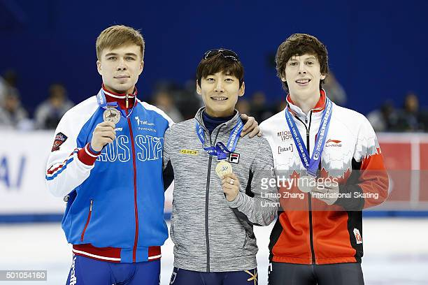 Third place winner Semen Elistratov of Russia First place winner Kwak YoonGy of South Korea and Second place winner Charle Cournoyer of Canada pose...