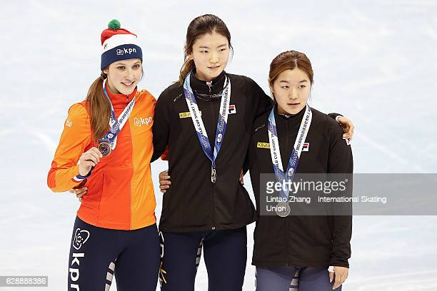 Third place winner Suzanne Schulting of the Netherland First place winner Shim Sukhee and Second place winner Kim Jiyoo of South Korea pose on the...