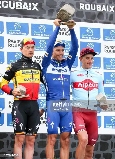 Third place Yves Lampaert of Belgium and Team Deceuninck Quick-Step, winner Philippe Gilbert of Belgium and Team Deceuninck Quick-Step, second place...