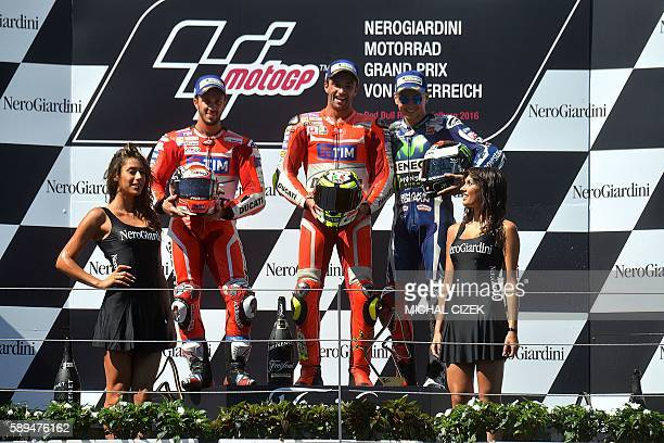 Third placed Andrea Davizioso of Italy the winner his compatriot Andrea Iannone and third placed Jorge Lorenzo of Spain celebrate at the podium after...