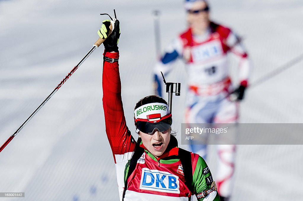 Third placed Belarus Darya Domracheva celebrates after competing in the women's 12,5 km mass start race Biathlon World Cup in Oslo on March 3, 2013.