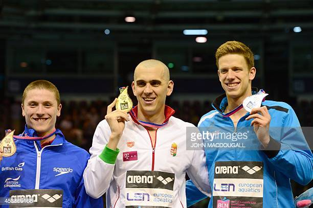 Third placed Britain's Roberto Pavoni gold winner Hungary's Laszlo Cseh and second placed Germany's Philip Heintz celebrate with their medals after...