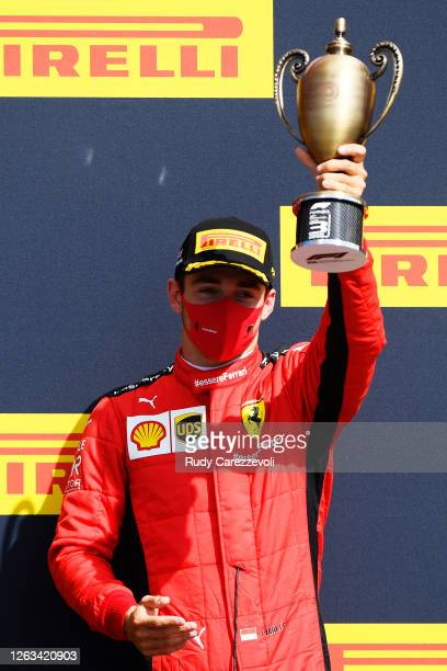 Third placed Charles Leclerc of Monaco and Ferrari celebrates on the podium during the F1 Grand Prix of Great Britain at Silverstone on August 02...