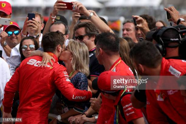 Third placed Charles Leclerc of Monaco and Ferrari celebrates with his team in parc ferme during the F1 Grand Prix of France at Circuit Paul Ricard...