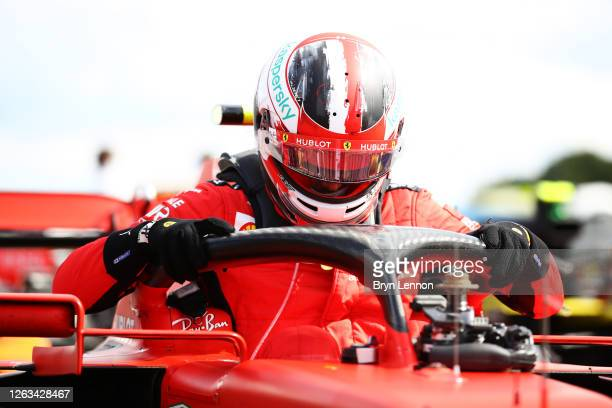 Third placed Charles Leclerc of Monaco and Ferrari climbs out of his car in parc ferme during the F1 Grand Prix of Great Britain at Silverstone on...