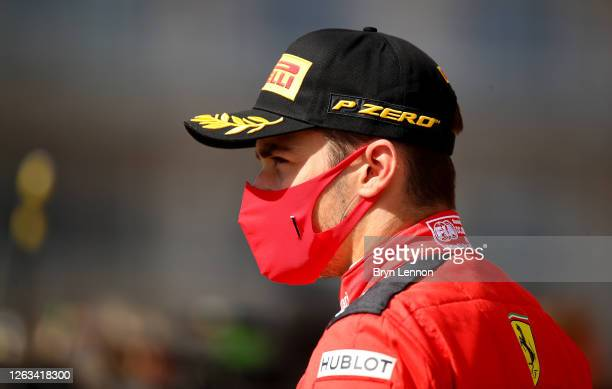 Third placed Charles Leclerc of Monaco and Ferrari on the podium during the F1 Grand Prix of Great Britain at Silverstone on August 02 2020 in...