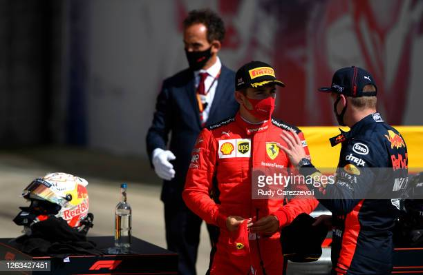 Third placed Charles Leclerc of Monaco and Ferrari talks to second placed Max Verstappen of Netherlands and Red Bull Racing after the F1 Grand Prix...