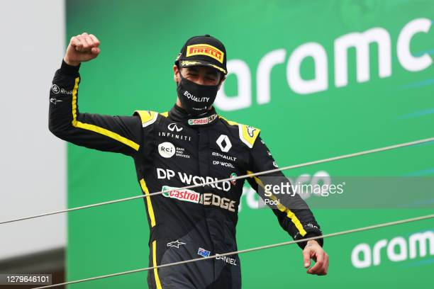 Third placed Daniel Ricciardo of Australia and Renault Sport F1 celebrates on the podium during the F1 Eifel Grand Prix at Nuerburgring on October...