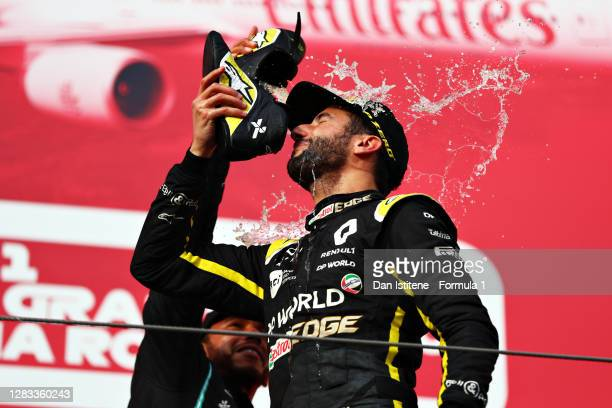 Third placed Daniel Ricciardo of Australia and Renault Sport F1 celebrates on the podium with a shoey during the F1 Grand Prix of Emilia Romagna at...