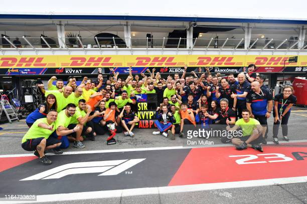 Third placed Daniil Kvyat of Russia and Scuderia Toro Rosso celebrates with his team after the F1 Grand Prix of Germany at Hockenheimring on July 28,...