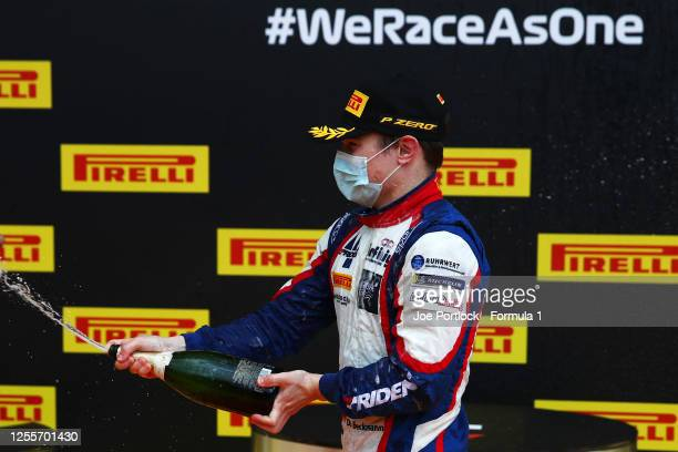 Third placed David Beckmann of Germany and Trident celebrates on the podium during the sprint race for the Formula 3 Championship at Red Bull Ring on...