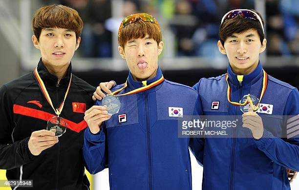 Third placed Dequan Chen of China winner Sin Da Woon of Korea and his compatriot Park Se Yeong celebrate on the podium after the men's 1500m final...