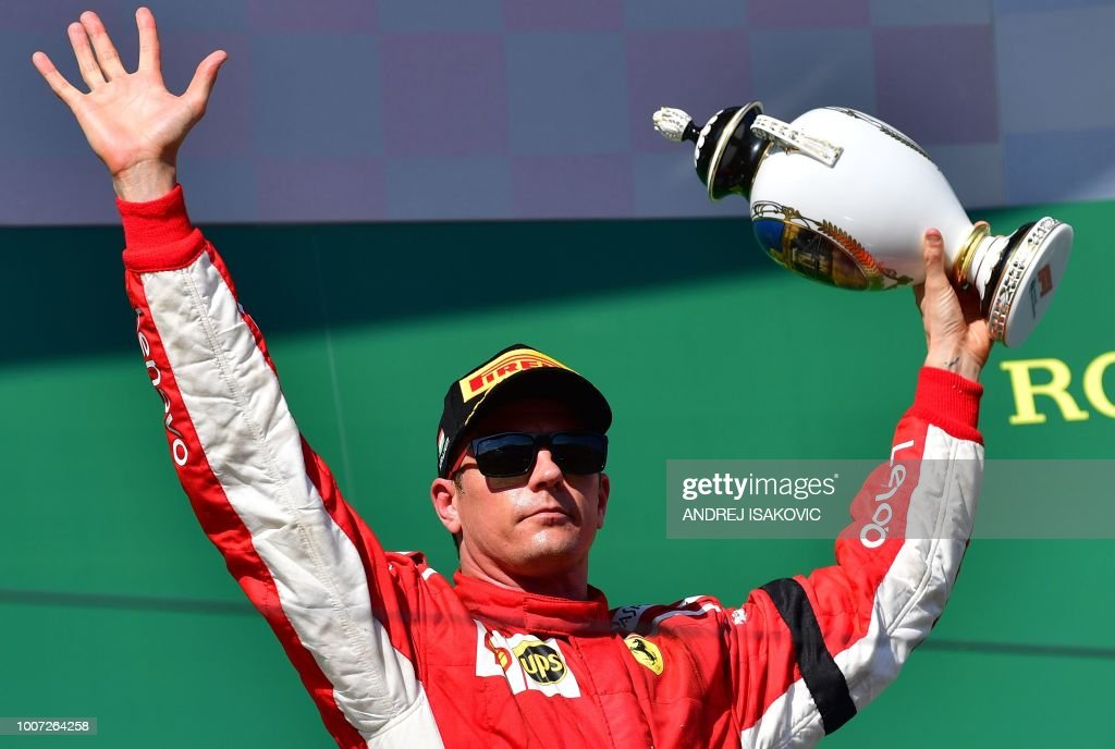 Third placed Ferrari's Finnish driver Kimi Raikkonen celebrates with his trophy after the Formula One Hungarian Grand Prix at the Hungaroring circuit in Mogyorod near Budapest, Hungary, on July 29, 2018.