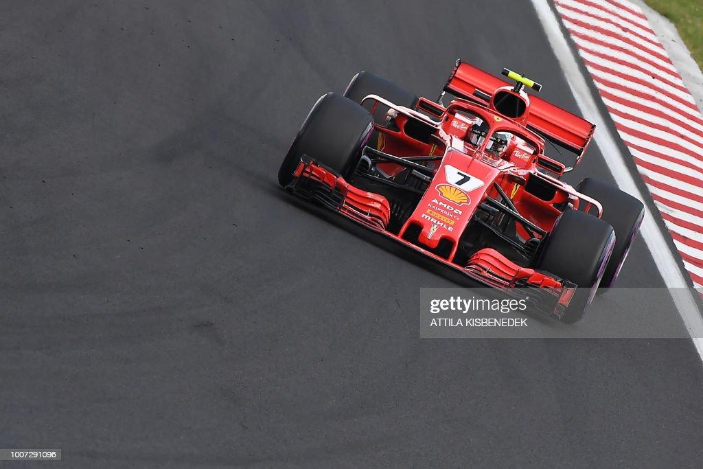 TOPSHOT - Third placed Ferrari's German Driver Kimi Raikkonen steers his car during the Formula One Hungarian Grand Prix at the Hungaroring circuit in Mogyorod near Budapest, Hungary, on July 29, 2018.