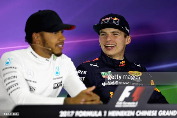 Third placed finisher Max Verstappen of Netherlands and Red Bull Racing with race winner Lewis Hamilton of Great Britain and Mercedes GP in the post...