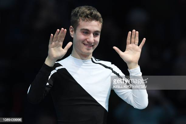 Third placed Italy's Matteo Rizzo reacts after the men's free skating event at the ISU European Figure Skating Championships in Minsk on January 26...