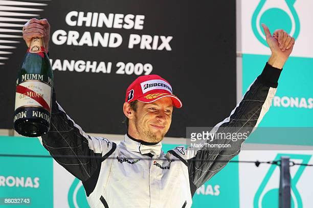 Third placed Jenson Button of Great Britain and Brawn GP celebrates on the podium after the Chinese Formula One Grand Prix at the Shanghai...