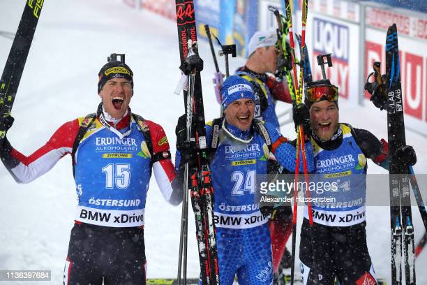 Third placed Julian Eberhard of Austria first placed Dominik Windisch of Italy and second placed Antonin Guigonnat of France following the Men's Mass...