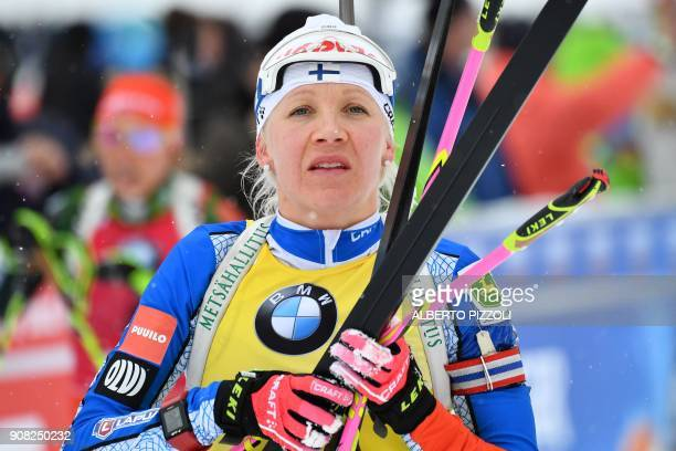 Third placed Kaisa Makarainen of Finland reacts after crossing the finish line of the Women's 125 km Mass Start Competition of the IBU World Cup...