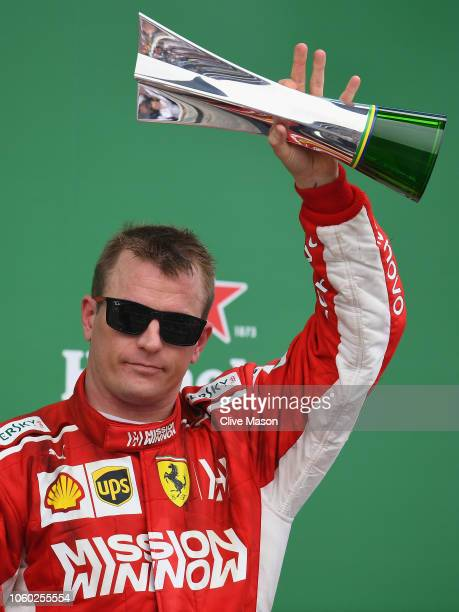 Third placed Kimi Raikkonen of Finland and Ferrari celebrates on the podium during the Formula One Grand Prix of Brazil at Autodromo Jose Carlos Pace...