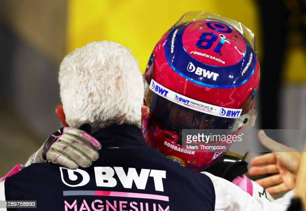 Third placed Lance Stroll of Canada and Racing Point celebrates with his father, Owner of Racing Point Lawrence Stroll in parc ferme during the F1...