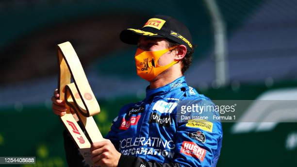 Third placed Lando Norris of Great Britain and McLaren F1 celebrates on the podium during the Formula One Grand Prix of Austria at Red Bull Ring on...