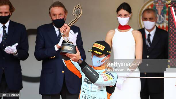 Third placed Lando Norris of Great Britain and McLaren F1 celebrates on the podium during the F1 Grand Prix of Monaco at Circuit de Monaco on May 23,...