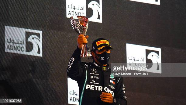 Third placed Lewis Hamilton of Great Britain and Mercedes GP celebrates on the podium during the F1 Grand Prix of Abu Dhabi at Yas Marina Circuit on...