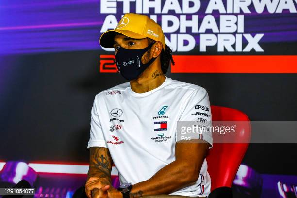 Third placed Lewis Hamilton of Great Britain and Mercedes GP talks in a press conference following the the F1 Grand Prix of Abu Dhabi at Yas Marina...