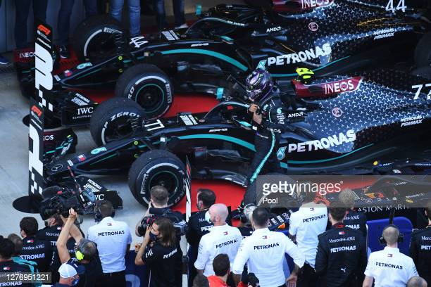 Third placed Lewis Hamilton of Great Britain and Mercedes GP walks in parc ferme during the F1 Grand Prix of Russia at Sochi Autodrom on September...