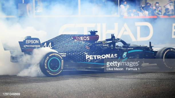 Third placed Lewis Hamilton of Great Britain driving the Mercedes AMG Petronas F1 Team Mercedes W11 does donuts after the F1 Grand Prix of Abu Dhabi...