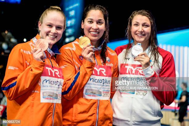 Third placed Make De Waard from Netherland winner Ranomi Kromowidjojo from Netherland and second placed Emilie Beckmann from Denmark pose after the...
