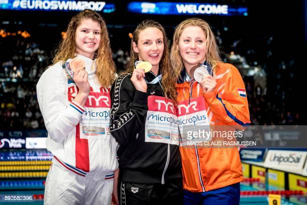 Third placed Maria Kameneva from Russia winner Katinka Hosszu from Hungary and second placed Kira Toussaint from Netherland pose after the 100 meter...