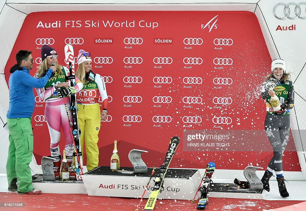 Third placed Marta Bassino of Italy celebrates with champagne next to second placed Mikaela Shiffrin (2L) of of USA and winner Lara Gut (3L) of Switzerland after the ladies' giant slalom of the FIS ski world cup in Soelden, Austria on October 22, 2016. / AFP / APA / HANS KLAUS TECHT / Austria OUT