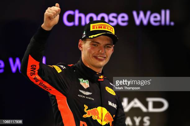 Third placed Max Verstappen of Netherlands and Red Bull Racing celebrates on the podium during the Abu Dhabi Formula One Grand Prix at Yas Marina...