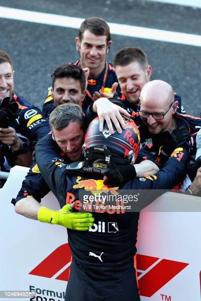 Third placed Max Verstappen of Netherlands and Red Bull Racing celebrates with his team in parc ferme during the Formula One Grand Prix of Japan at...