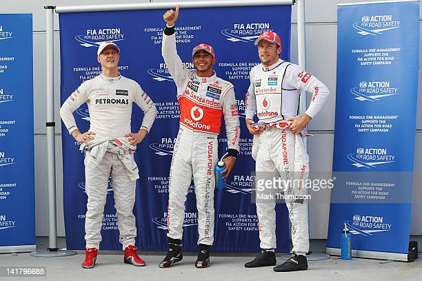 Third placed Michael Schumacher of Germany and Mercedes GP, pole sitter Lewis Hamilton of Great Britain and McLaren and second placed Jenson Button...