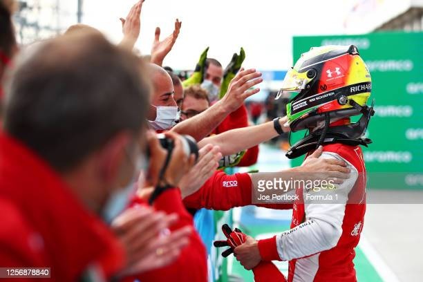 Third placed Mick Schumacher of Germany and Prema Racing celebrates in parc ferme during the feature race for the Formula 2 Championship at...