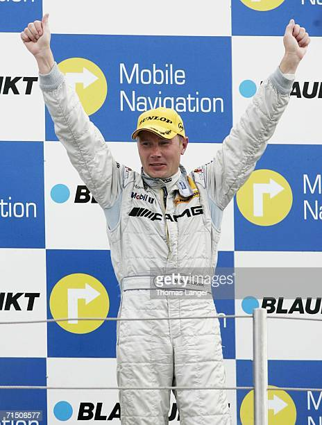 Third placed Mika Hakkinen of AMG Mercedes celebrates on the podium after the DTM 2006 German Touring Car Championship Round 5 on July 23, 2006 in...