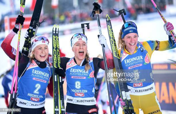 Third placed Norway's Ingrid Landmark Tandrevold, winner Norway's Tiril Eckhoff and second placed Sweden's Hanna Oeberg celebrate after the IBU...