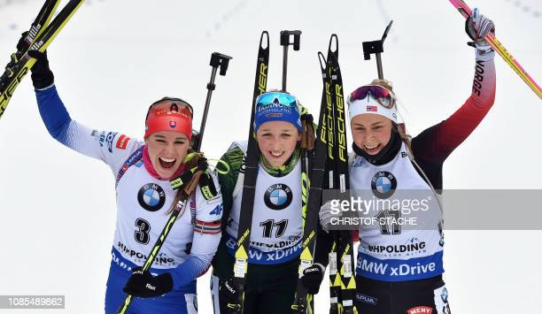 Third placed Paulina Fialkova of Slovakia, winner Franziska Preuss of Germany and second placed Ingrid Landmark Tandrevold of Norway celebrate after...