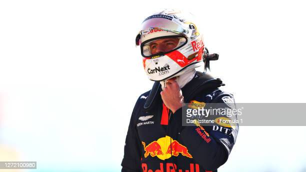 Third placed qualifier Max Verstappen of Netherlands and Red Bull Racing looks on in parc ferme during qualifying for the F1 Grand Prix of Tuscany at...