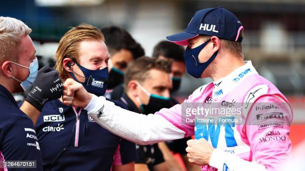 Third placed qualifier Nico Hulkenberg of Germany and Racing Point celebrates with his team in parc ferme during qualifying for the F1 70th...