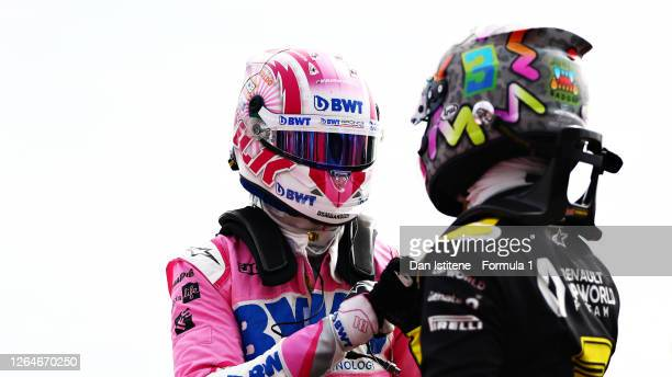 Third placed qualifier Nico Hulkenberg of Germany and Racing Point celebrates with fifth place qualifier Daniel Ricciardo of Australia and Renault...