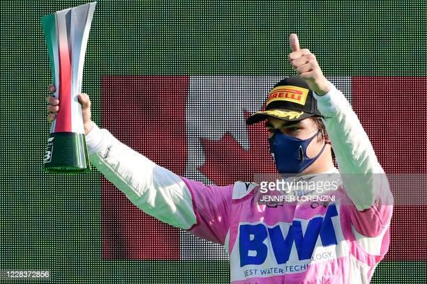Third placed Racing Point's Canadian driver Lance Stroll celebrates on the podium after the Italian Formula One Grand Prix at the Autodromo Nazionale...