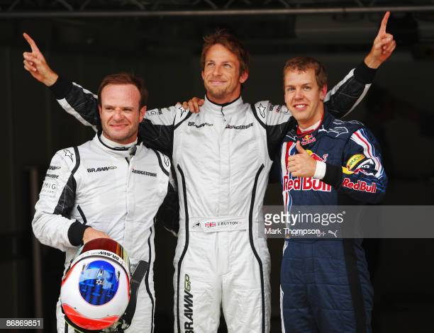 Third placed Rubens Barrichello of Brazil and Brawn GP pole sitter Jenson Button of Great Britain and Brawn GP and second placed Sebastian Vettel of...